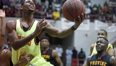 Malik Newman drives to the basket and scores against Provine despite being held in the finals of the JPS Holiday Tournament on Monday night, December 29, 2014, at Forest Hill High School in Jackson.