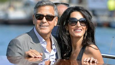 George Clooney and Amal Alamuddin ride a taxi boat before their Sept. 27 wedding in Venice.