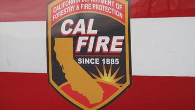 Cal Fire firefighters are at the scene of a tree fire that's threatening a home on De Plata Avenue in Indio.