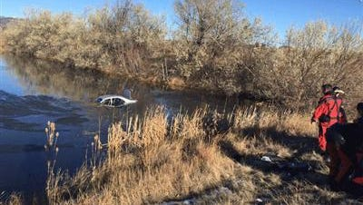 A jogger in Boulder discovered a vehicle submerged in a pond with at least one person inside on Sunday morning, according to the Colorado State Patrol.