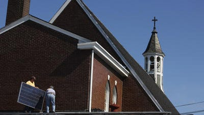 Putting solar panels on the roof of a Louisville church.
