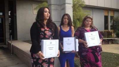 Greenfield parents address the news media before submitting their petition for unification at the Monterey County Office of Education in Salinas in October.