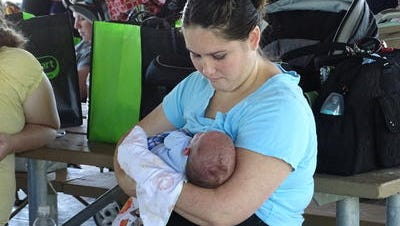 "Amy Mitchell and baby Zane, of Fremont, participate in the ""Big Latch On"" in Clyde."