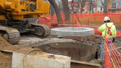 Metropolitan Sewer District workers install pipes and wells as part of a massive overhaul of Hamilton County's sewer system.