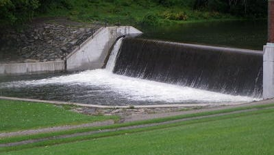 Water flows out of Lake Hopatcong at the spillway in Hopatcong State Park.