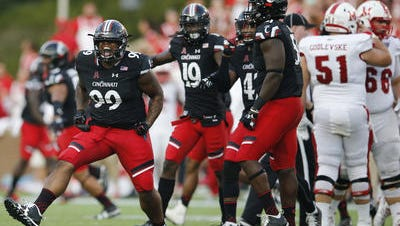 Celebrations have been rare lately for the UC Bearcats, but defensive tackle Alex Pace (99) and his teammates say there is plenty of time to turn the season around.