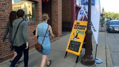 People roam the streets of downtown to score deals at local businesses, jam to live music and check out other entertainment and activities at a 2015 First Thursdays event