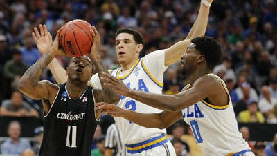 Gary Clark (11) drives to the basket against UCLA in the Bearcats' second-round NCAA Tournament loss in March. Lonzo Ball (center) and several of his former UCLA teammates will not return as UC starts a series with the Bruins next season.