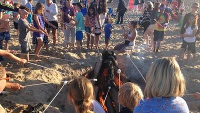 In this May, 2016 photo, families enjoy a bonfire on the sand in Dewey Beach. On Tuesday, June 6, 2017, Delaware authorities issued a swimming advisory at Dagsworthy Beach in Dewey because of elevated bacteria in the water, likely from recent excessive rainfall.