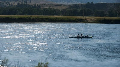 Kayakers float down the Missouri River near Wolf Creek Bridge Sunday, July 16. The body of Brandy Pavitt, 35, was recovered in the area Sunday morning.
