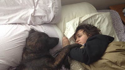 """Bethany Anne Galdes with her dog, Kodiac. Bethany's mom, Cathy, said Kodiak provided """"a reason to get out of bed"""" for Bethany."""