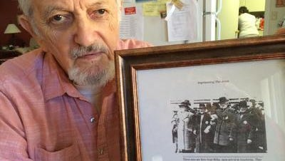 Edward Heisler, in 2015, with the last picture ever taken of his father, who died in the Holocaust.