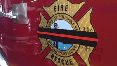 The door of a City of Poughkeepsie Fire Department truck inside the Clover Street Station.