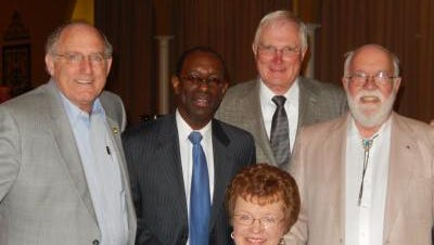 Former colleagues Bill Smith, Alvin Williams, Bill Schoell, and Tom Smith joined Dolly Loyd at a reception held in her honor in September.