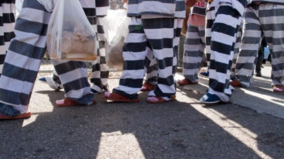 Undocumented immigrants at  Phoenix's tent city jail.