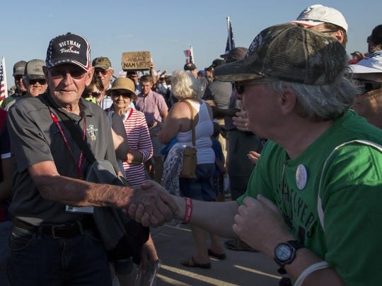 Vietnam veterans return from a honor flight back to AirVenture on Friday, July 24.