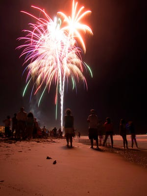 Fireworks explode over Sidney Fischer Park in  Cocoa Beach.