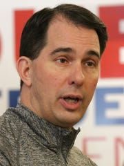 Wisconsin Gov. Scott Walker talks to supporters at