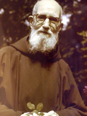 A photograph of Father Solanus Casey, taken at age 86, on display in the museum portion of the Solanus Casey Center in Detroit.