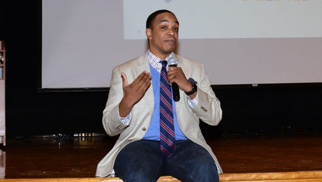 """Jordan Burnham speaking about suicide prevention at the """"Just Talk About It"""" forum held at George Washington Middle School."""