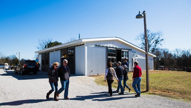 People walk outside of the Harvest Moon Pavilion  at the Bobby Lanier Farm Park Hay and Barn Stable in Germantown. The Harvest Moon Pavilion will host guests for the Farm to Table Dinner on Sunday.