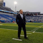 Oct 3, 2015; Lexington, KY, USA; Kentucky Wildcats head coach Mark Stoops walks on the field before the game against the Eastern Kentucky Colonels at Commonwealth Stadium.