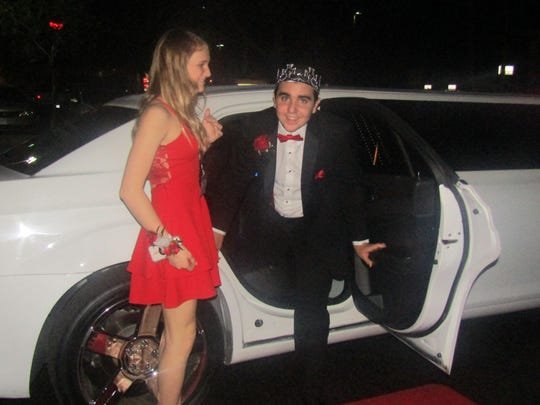 Christa Stone escorts her prom king to the Tim Tebow