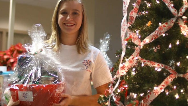 Jessica DeFrance, a senior at Classical Christian Academy, stands with one of her gift baskets in the Neonatal Intensive Care Unit at Golisano Children's Hospital.