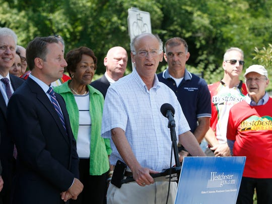 Greenburgh Town Supervisor Paul Feiner speaks at a 2016 press conference announcing a link between the North County and South County Trailways at Route 119 in Elmsford. Feiner now wants to link the trailways to the shared-use path on the Gov. Mario M. Cuomo Bridge via a bike path along Route 119.