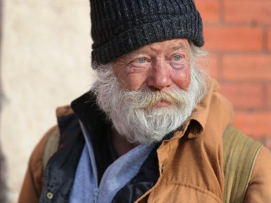 Homeless El Pasoan Mark, a veteran, walks downtown