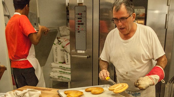 Head Chef Rainer  Krischkewski of Germany applies his skill at ZuHause Bakery in Lafayette