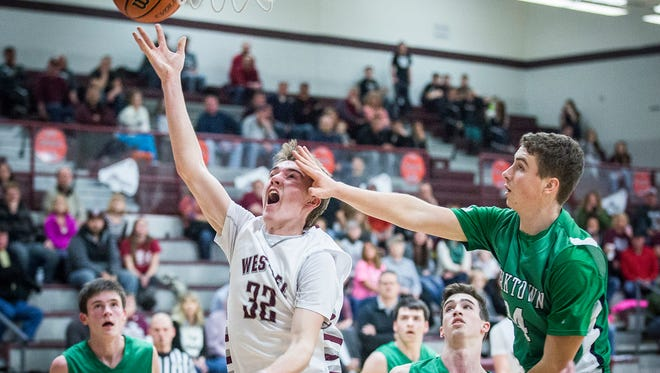 Wes-Del's Sam Smoot shoots past Yorktown's defense during their game at Wes-Del High School Thursday, Feb. 11, 2016.