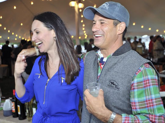 Sam Calagione, founder and president of Dogfish Head Craft Brewery, with his cousin, mixologist Mia Mastroianni of Los Angeles who flew in for the spirits launch party.