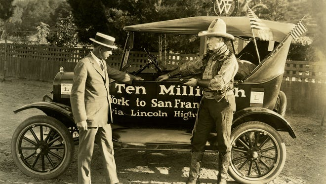 """Henry Ford, left, is photographed with William S. Hart, an American silent film actor, screenwriter, director and producer with the Ten-Millionth Ford Model T in California in 1924.  The side of Model T reads: """"The Ten Millionth New York to San Francisco via Lincoln Highway."""""""