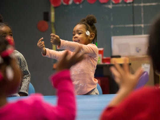 Ahlana Moore, 3, join her friends in the pre-school class singing sons at the West Center City Early Learning Center at 600 N. Madison Street in Wilmington which is moving out of the area due to all the gun violence.