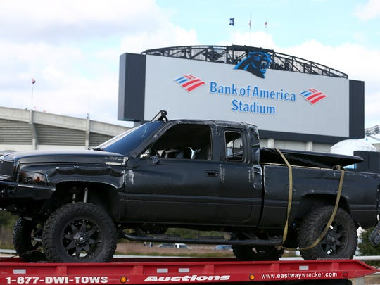 Cam Newton's pickup truck is towed away from in front