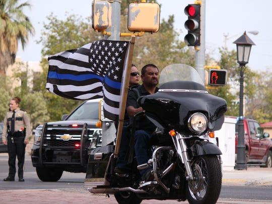 Ramon Pena displays his pride and respect for fallen Lt. Richard Cowles during Friday's memorial services.