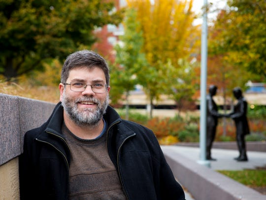 Jeff Suess, The Enquirer's librarian, poses for a portrait