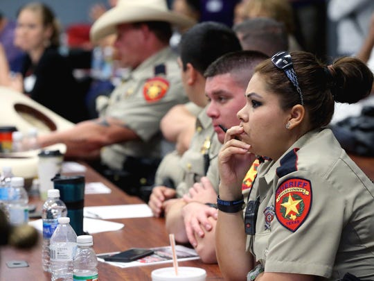 Members of the Nueces County Sheriff's Office attend the Stop the Silence on Domestic Violence Summit on Friday, Dec. 2, 2016, at the Del Mar College Center for Economic Development in Corpus Christi.