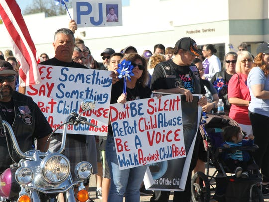 Carlsbad residents carried signs and wore T-shirts at the fifth annual Walk Against Child Abuse.