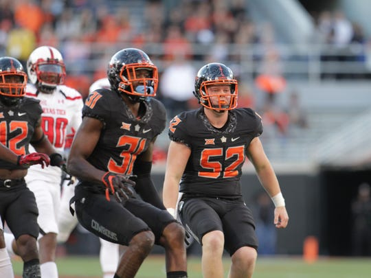 Oklahoma State long snapper Tanner Morgan (52) covers a punt during last year's game against Texas Tech. Morgan is a former Ankeny Centennial standout.