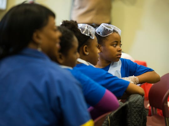 "Participants in a STEM inspired ""Girls Empowerment"" event get ready to spend the morning doing science experiments in November 2017 at the Wilmington Parks & Recreation Municipal Building."