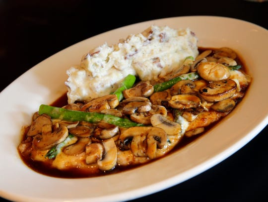 Chicken Madeira, sautéed chicken breast topped with