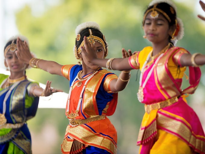 Sandra Jose, center, 10, dances a traditional Diwali