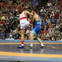 Gilman wrestles to finals at first World Championships