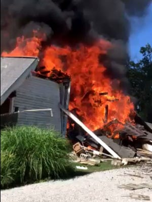 A screengrab of video from a house explosion and fire in the 1700 block of Hercules Avenue in Evansville.
