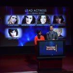 Mindy Kaling, left, and Carson Daly announce the nominations for outstanding lead actress in a drama series at the 66th Primetime Emmy Awards nominations ceremony.