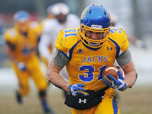 In this photo taken on Saturday, Nov. 22, 2014, South Dakota State's Zach Zenner (31) runs the ball in for a touchdown against University of South Dakota after receiving a pass during the first half of the South Dakota Showdown Series game at Coughlin–Alumni Stadium in Brookings, S.D.  Zenner isn't as complete as advertised. Can't be. That's the contrarian angle some NFL scouts quietly have chased during visits to Brookings. This is where things stand after four seasons of outstanding production on the field combined with extensive tales of off-field efforts: Professional talent evaluators feel compelled to be next-level skeptical of the South Dakota State running back if only because he's not the norm. He's a well-rounded star in the era of the anti-hero athlete. (AP Photo/Argus Leader, Joe Ahlquist)