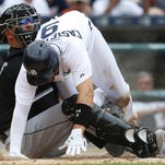 Detroit Tigers' Nick Castellanos, right, is tagged out at home by Chicago White Sox catcher Tyler Flowers on a Jose Iglesias fielders choice in the fourth inning of a baseball game, Thursday in Detroit.