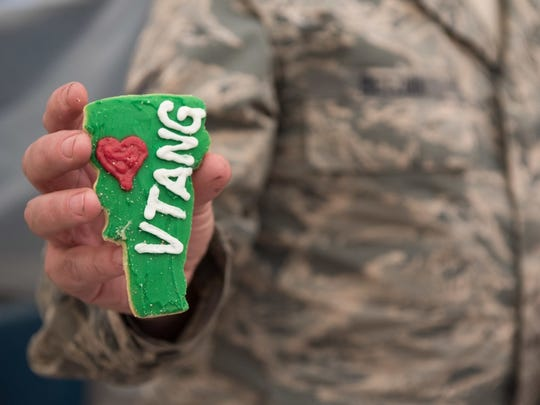 An Airman assigned to the 407th Expeditionary Maintenance Squadron holds a cookie sent in a care package to the 407th Air Expeditionary Group, Southwest Asia, Dec. 25, 2016. The Airman is one of many deployed from the Vermont Air National Guard. Photo provided by the U.S. Air Force, Sunday, Dec. 25, 2016.